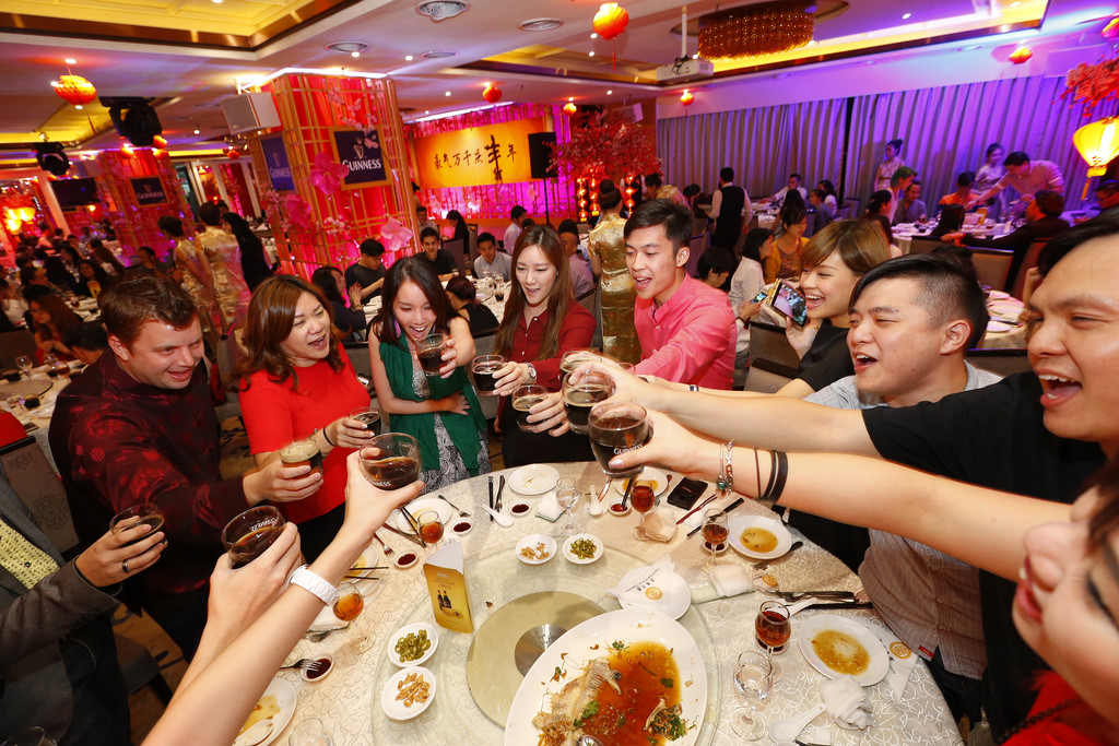 11. Members of the media toasting to a New Year